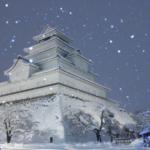 粉雪舞う会津若松城